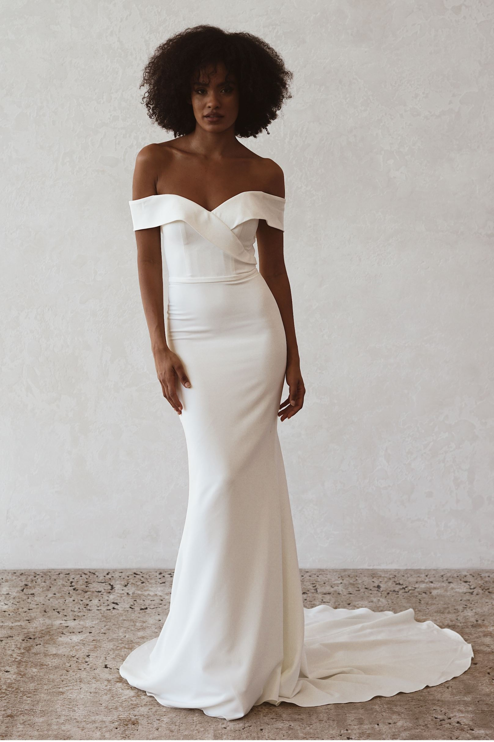 Model wearing a Off the Shoulder gown