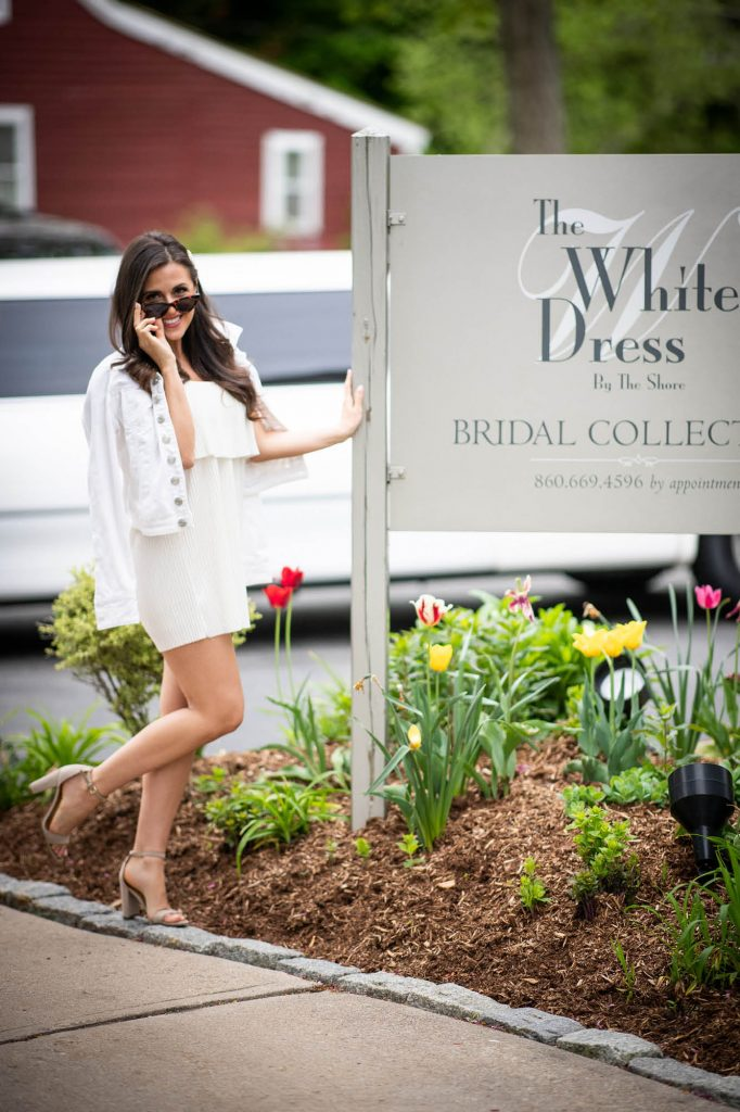 The White Dress by the shore sign and Marisa Hunter